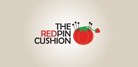 red pin cushion logo