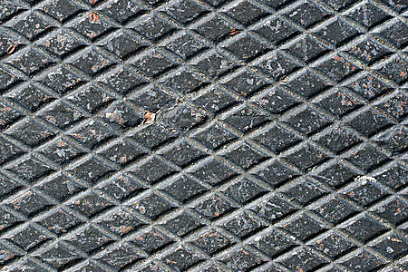 Diamond pattern on weathered black metal