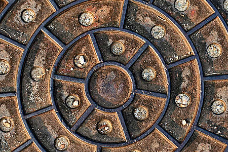 Circular cover on metal manhole cover