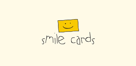 smile cards yellow logo
